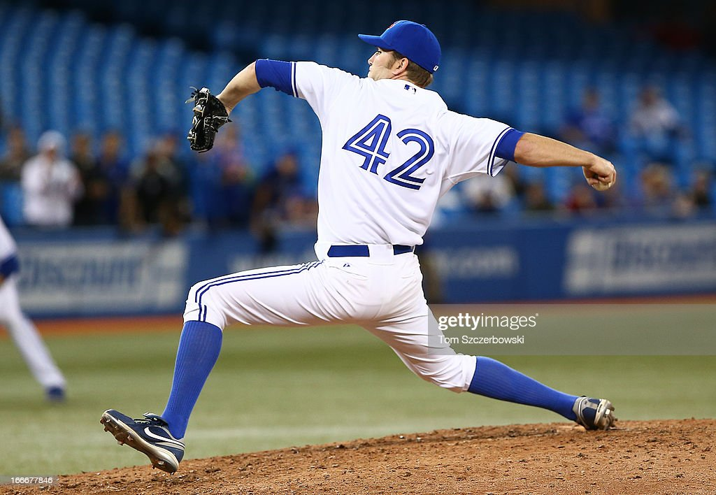<a gi-track='captionPersonalityLinkClicked' href=/galleries/search?phrase=Casey+Janssen&family=editorial&specificpeople=598479 ng-click='$event.stopPropagation()'>Casey Janssen</a> of the Toronto Blue Jays delivers a pitch during MLB game action against the Chicago White Sox on April 15, 2013 at Rogers Centre in Toronto, Ontario, Canada. All uniformed team members are wearing jersey number 42 in honor of Jackie Robinson Day.