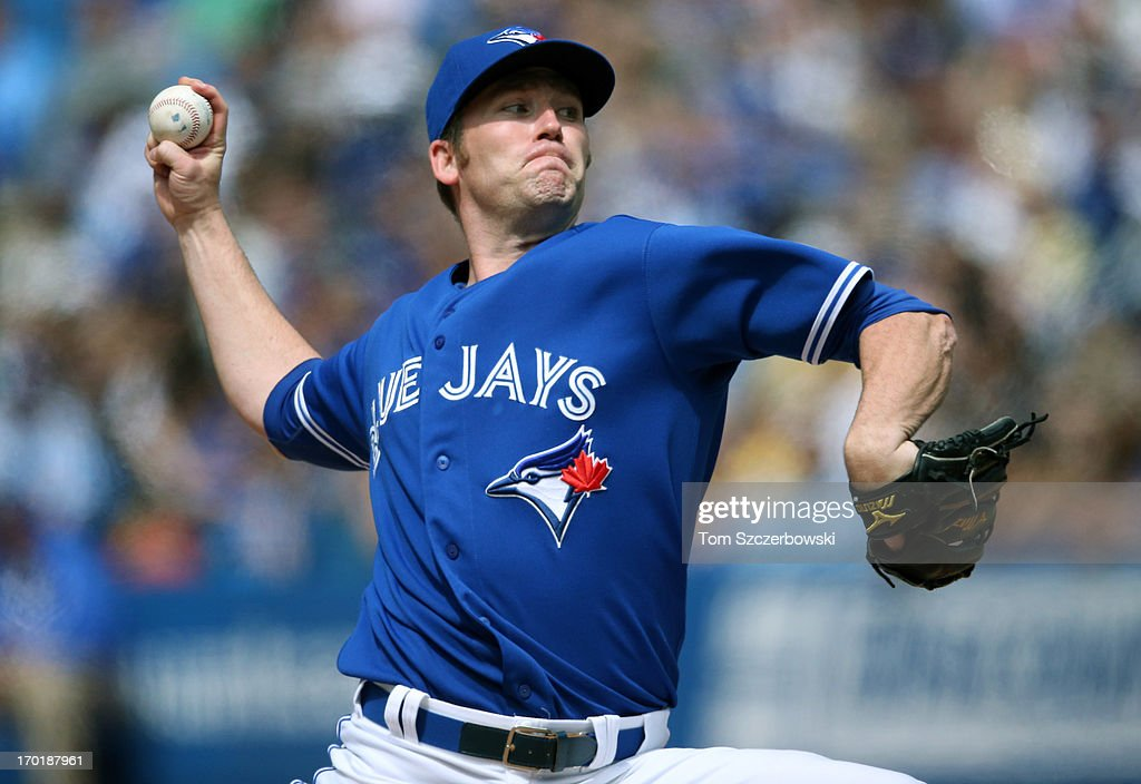 <a gi-track='captionPersonalityLinkClicked' href=/galleries/search?phrase=Casey+Janssen&family=editorial&specificpeople=598479 ng-click='$event.stopPropagation()'>Casey Janssen</a> #44 of the Toronto Blue Jays delivers a pitch during MLB game action against the Texas Rangers on June 8, 2013 at Rogers Centre in Toronto, Ontario, Canada.