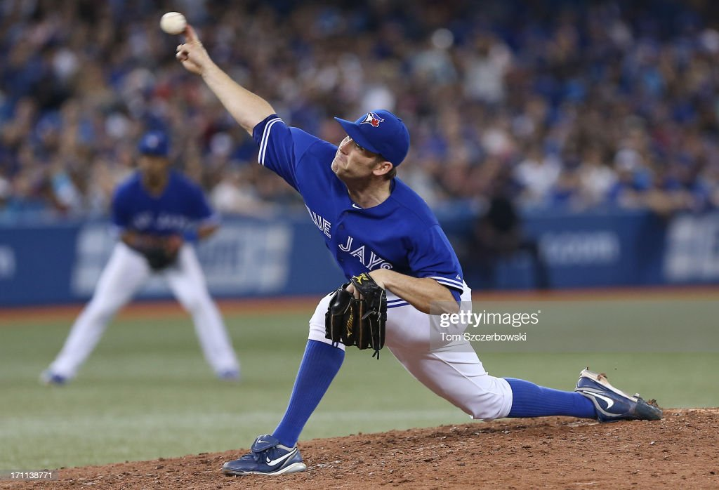 <a gi-track='captionPersonalityLinkClicked' href=/galleries/search?phrase=Casey+Janssen&family=editorial&specificpeople=598479 ng-click='$event.stopPropagation()'>Casey Janssen</a> #44 of the Toronto Blue Jays delivers a pitch during MLB game action against the Baltimore Orioles on June 22, 2013 at Rogers Centre in Toronto, Ontario, Canada.