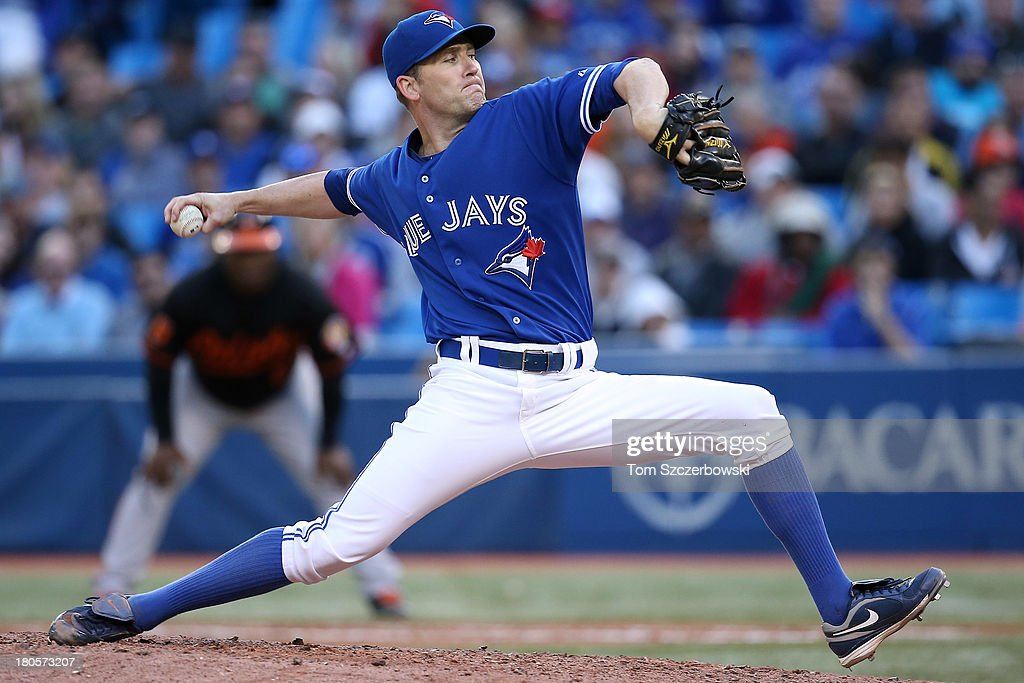 <a gi-track='captionPersonalityLinkClicked' href=/galleries/search?phrase=Casey+Janssen&family=editorial&specificpeople=598479 ng-click='$event.stopPropagation()'>Casey Janssen</a> #44 of the Toronto Blue Jays delivers a pitch in the ninth inning during MLB game action against the Baltimore Orioles on September 14, 2013 at Rogers Centre in Toronto, Ontario, Canada.