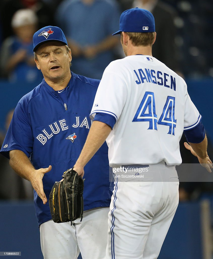 <a gi-track='captionPersonalityLinkClicked' href=/galleries/search?phrase=Casey+Janssen&family=editorial&specificpeople=598479 ng-click='$event.stopPropagation()'>Casey Janssen</a> #44 of the Toronto Blue Jays is congratulated by manager <a gi-track='captionPersonalityLinkClicked' href=/galleries/search?phrase=John+Gibbons&family=editorial&specificpeople=218120 ng-click='$event.stopPropagation()'>John Gibbons</a> #5 after their victory during MLB game action against the Colorado Rockies on June 19, 2013 at Rogers Centre in Toronto, Ontario, Canada.