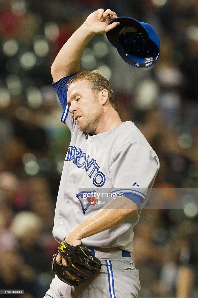 <a gi-track='captionPersonalityLinkClicked' href=/galleries/search?phrase=Casey+Janssen&family=editorial&specificpeople=598479 ng-click='$event.stopPropagation()'>Casey Janssen</a> #44 of the Toronto Blue Jays reacts after giving up a run during the ninth inning against the Cleveland Indians at Progressive Field on July 10, 2013 in Cleveland, Ohio.