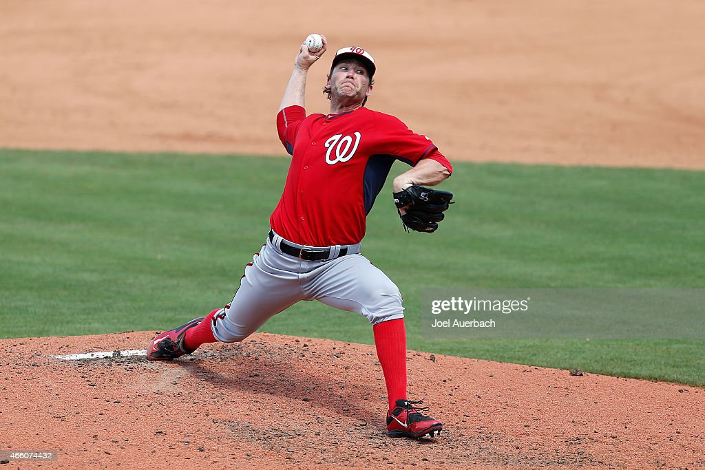 <a gi-track='captionPersonalityLinkClicked' href=/galleries/search?phrase=Casey+Janssen&family=editorial&specificpeople=598479 ng-click='$event.stopPropagation()'>Casey Janssen</a> #44 of the Washington Nationals throws the ball against the New York Mets in the fourth inning during a spring training game at Tradition Field on March 12, 2015 in Port St. Lucie, Florida. The Mets defeated the Nationals 11-9.