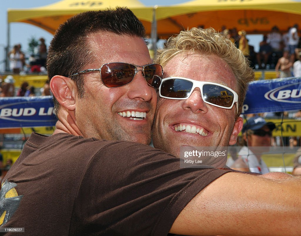Casey Jennings (right) is embraced by announcer Chris McGee during the AVP Hermosa Beach Open men's final in Hermosa Beach, Calif. on Saturday, July 23, 2005. Jennings teamed with Matt Fuerbringer to defeat Dax Holdren and Jeff Nygaard in the final, 19-21, 21-16, 15-13.