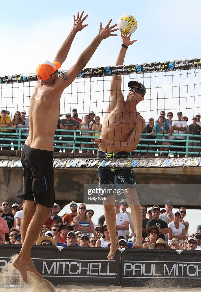 Casey Jennings (R) tries to get the ball past Phil Dalhausser (L) during the men's finals at the AVP Manhattan Beach Open on August 25, 2013 in Manhattan Beach, California. Jennings and his partner Matt Fuerbringer defeated Phil Dalhausser and Sean Rosenthal 21-18, 21-23, 15-12.