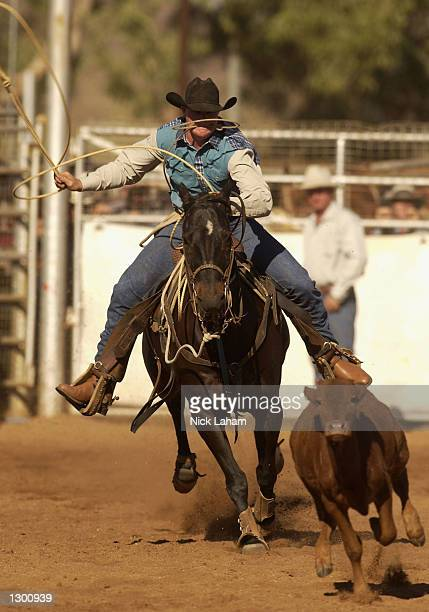 Casey Kenny in pursuit of a calf at the Rope and Tie event during the first day of the Mount Isa Rodeo August 9 2002 at Mount Isa Australia The rodeo...