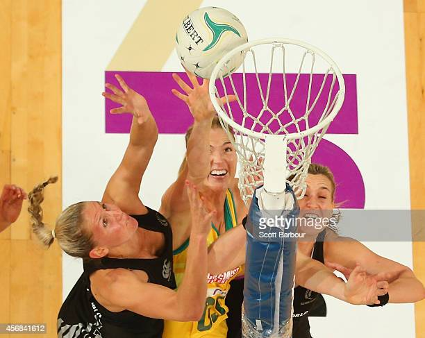 Casey Kopua and Leana de Bruin of the Silver Ferns and Caitlin Bassett of the Diamonds compete for the ball during the International Test match...