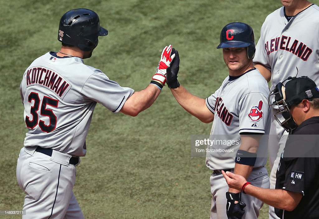 <a gi-track='captionPersonalityLinkClicked' href=/galleries/search?phrase=Casey+Kotchman&family=editorial&specificpeople=240573 ng-click='$event.stopPropagation()'>Casey Kotchman</a> #35 of the Cleveland Indians is congratulated by <a gi-track='captionPersonalityLinkClicked' href=/galleries/search?phrase=Lou+Marson&family=editorial&specificpeople=4175358 ng-click='$event.stopPropagation()'>Lou Marson</a> #6 after hitting a 2-run home run during MLB game action against the Toronto Blue Jays on July 14, 2012 at Rogers Centre in Toronto, Ontario, Canada.