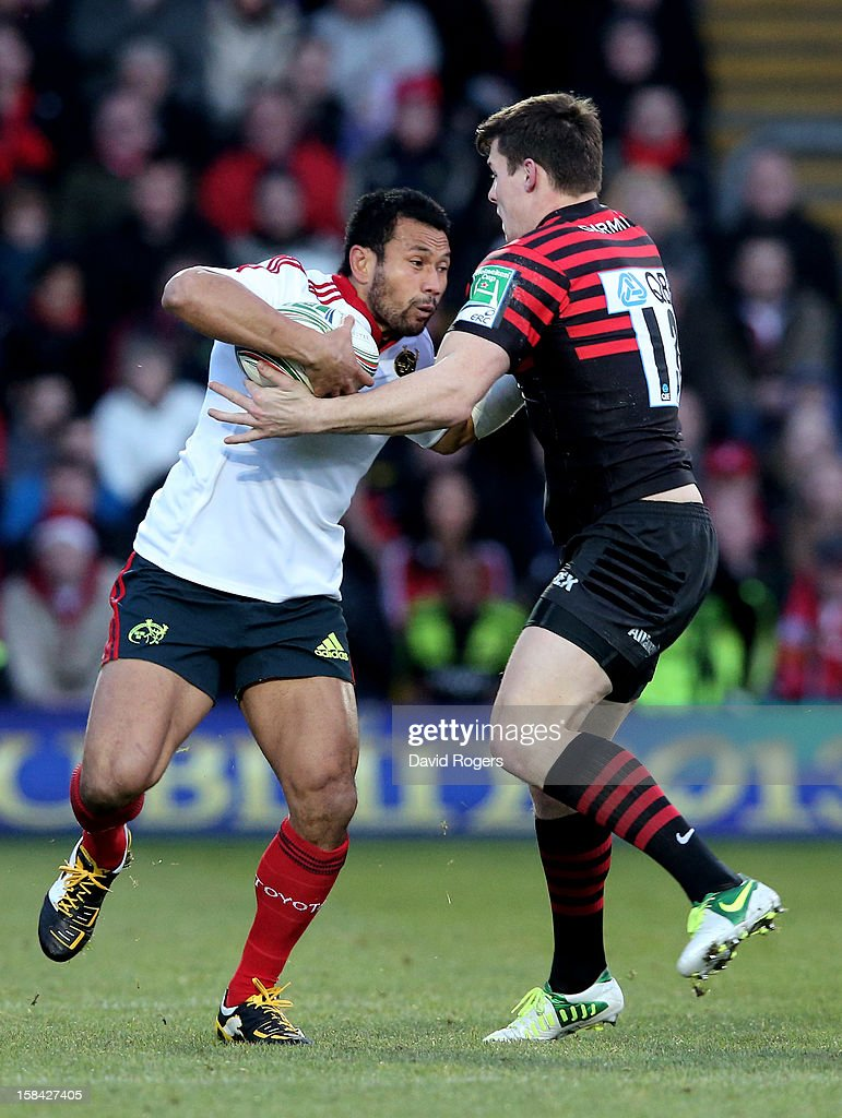 <a gi-track='captionPersonalityLinkClicked' href=/galleries/search?phrase=Casey+Laulala&family=editorial&specificpeople=563480 ng-click='$event.stopPropagation()'>Casey Laulala</a> of Munster is tackled by Joel Tomkins of Saracens during the Heineken Cup pool one match between Saracens and Munster at Vicarage Road on December 16, 2012 in Watford, United Kingdom.