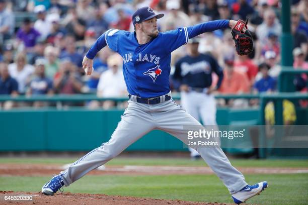 Casey Lawrence of the Toronto Blue Jays pitches against the Atlanta Braves during the spring training game at Champion Stadium on February 25 2017 in...