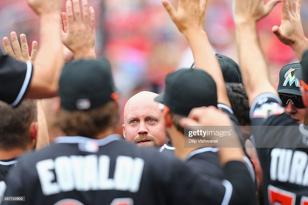 <a gi-track='captionPersonalityLinkClicked' href=/galleries/search?phrase=Casey+McGehee&family=editorial&specificpeople=796577 ng-click='$event.stopPropagation()'>Casey McGehee</a> #9 of the Miami Marlins is congratulated in the dugout after scoring the game-winning run in the ninth inning against the St. Louis Cardinals at Busch Stadium on July 5, 2014 in St. Louis, Missouri. The Marlins beat the Cardinal 6-5.