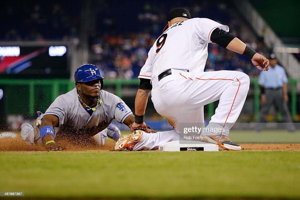 Casey McGehee of the Miami Marlins tags out Yasiel Puig of the Los Angeles Dodgers during the eighth inning of the game at Marlins Park on May 02...