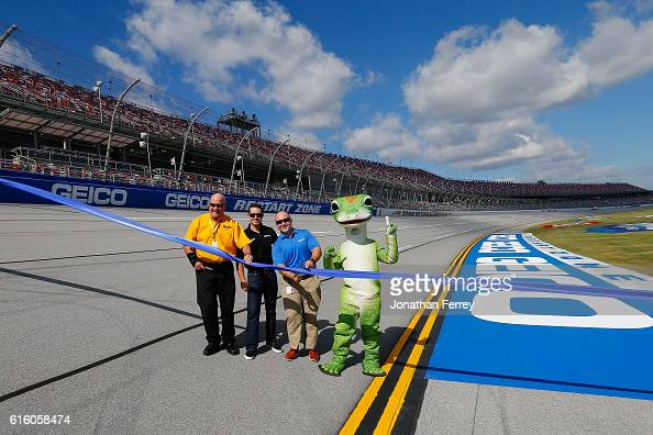 Casey Mears driver of the GEICO Chevrolet and representatives from GEICO announce the GEICO Restart Zone prior to practice for the NASCAR Sprint Cup...