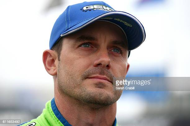 Casey Mears driver of the GEICO Chevrolet looks on prior to qualifying for the NASCAR Sprint Cup Series Citizen Solider 400 at Dover International...