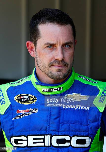 Casey Mears driver of the GEICO Chevrolet stands in the garage area during practice for the NASCAR Sprint Cup Series Toyota/Save Mart 350 at Sonoma...