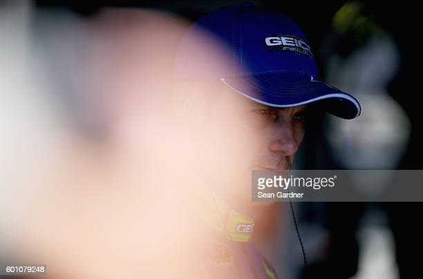 Casey Mears driver of the GEICO Chevrolet stands in the garage area during practice for the NASCAR Sprint Cup Series Federated Auto Parts 400 at...