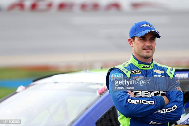 Casey Mears driver of the GEICO Chevrolet stands on the grid during qualifying for the NASCAR Sprint Cup Series CampingWorldcom 500 at Talladega...