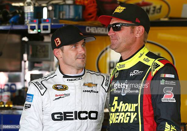 Casey Mears driver of the GEICO Chevrolet talks to Clint Bowyer driver of the 5hour Energy Chevrolet during practice for the NASCAR Sprint Cup Series...