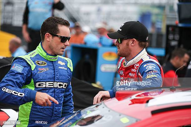 Casey Mears driver of the GEICO Chevrolet talks to JJ Yeley driver of the Dr Pepper Toyota during qualifying for the NASCAR Sprint Cup Series CheezIt...