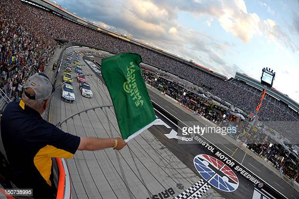 Casey Mears driver of the GEICO Ford and Brad Keselowski driver of the Miller Lite Dodge lead the field to the green flag to start the NASCAR Sprint...