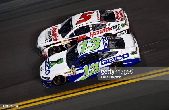 Casey Mears driver of the GEICO Ford and Kasey Kahne driver of the Hendrickcarscom Chevrolet race during the NASCAR Sprint Cup Series Coke Zero 400...