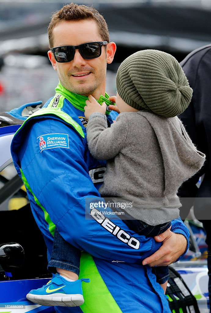Casey Mears, driver of the #13 GEICO Ford, holds his son Hayden on the grid prior to the NASCAR Sprint Cup Series Food City 500 at Bristol Motor Speedway on March 17, 2013 in Bristol, Tennessee.