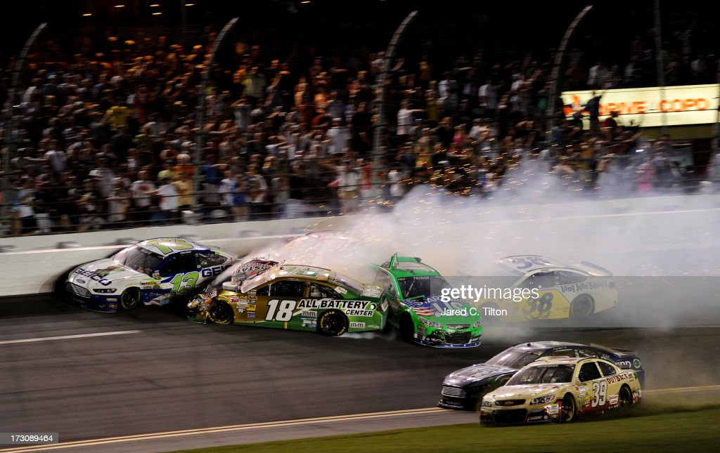 Casey Mears, driver of the #13 GEICO Ford, Kyle Busch, driver of the #18 Interstate Batteries Toyota, Danica Patrick, driver of the #10 GoDaddy.com Chevrolet, JJ Yeley, driver of the #36 Golden Corral Chevrolet, and David Gilliland, driver of the #38 Long John Silver's Ford, are involved in an incident during the NASCAR Sprint Cup Series Coke Zero 400 at Daytona International Speedway on July 6, 2013 in Daytona Beach, Florida..
