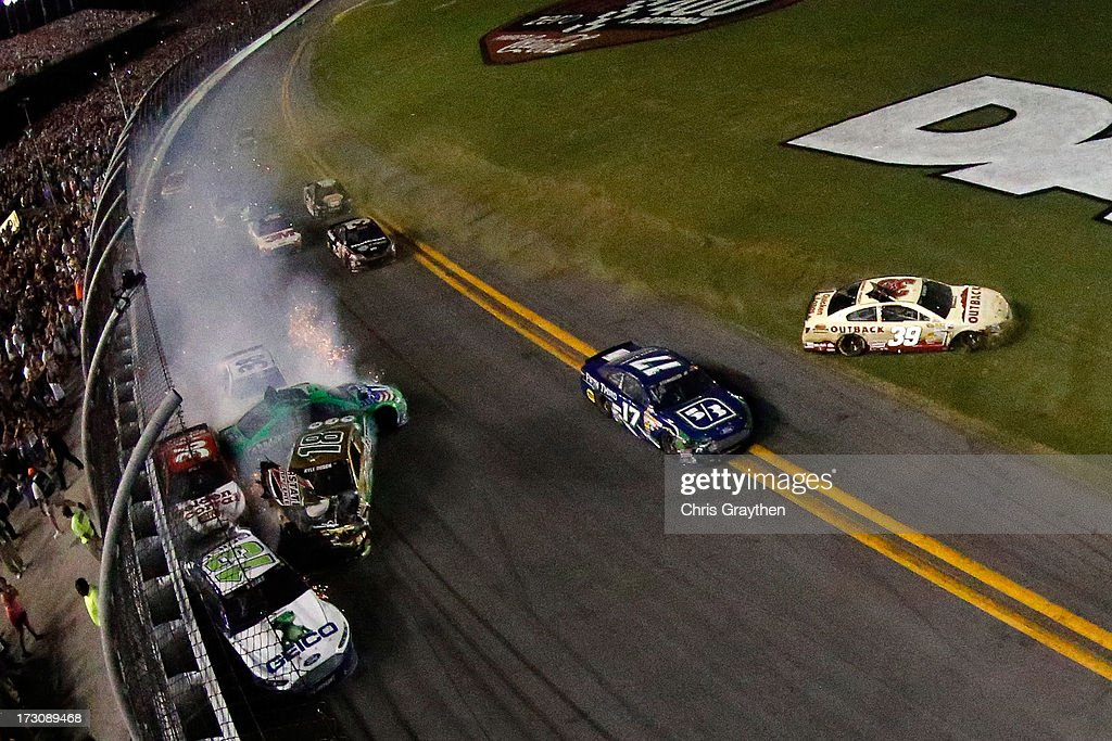 <a gi-track='captionPersonalityLinkClicked' href=/galleries/search?phrase=Casey+Mears&family=editorial&specificpeople=176485 ng-click='$event.stopPropagation()'>Casey Mears</a>, driver of the #13 GEICO Ford, Kyle Busch, driver of the #18 Interstate Batteries Toyota, <a gi-track='captionPersonalityLinkClicked' href=/galleries/search?phrase=Danica+Patrick&family=editorial&specificpeople=183352 ng-click='$event.stopPropagation()'>Danica Patrick</a>, driver of the #10 GoDaddy.com Chevrolet, JJ Yeley, driver of the #36 Golden Corral Chevrolet, and <a gi-track='captionPersonalityLinkClicked' href=/galleries/search?phrase=David+Gilliland&family=editorial&specificpeople=543432 ng-click='$event.stopPropagation()'>David Gilliland</a>, driver of the #38 Long John Silver's Ford, are involved in an incident during the NASCAR Sprint Cup Series Coke Zero 400 at Daytona International Speedway on July 6, 2013 in Daytona Beach, Florida..