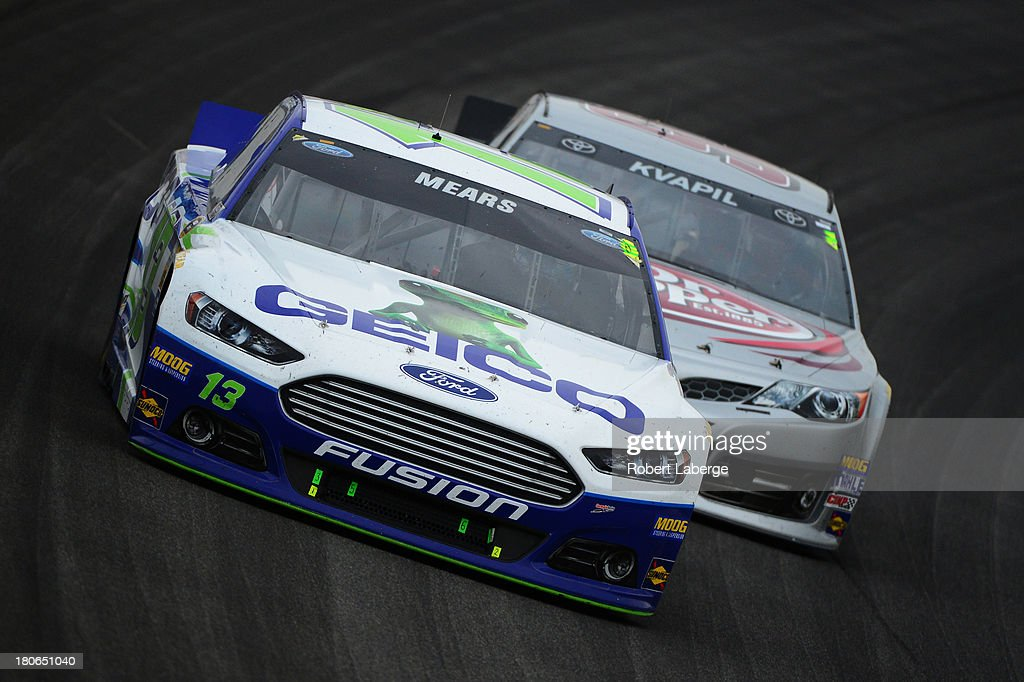 Casey Mears, driver of the #13 GEICO Ford, leads Travis Kvapil, driver of the #93 Burger King/Dr. Pepper Toyota, during the NASCAR Sprint Cup Series Geico 400 at Chicagoland Speedway on September 15, 2013 in Joliet, Illinois.