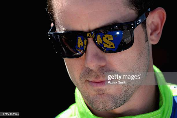 Casey Mears driver of the GEICO Ford looks on during practice for the NASCAR Sprint Cup Series Coke Zero 400 at Daytona International Speedway on...