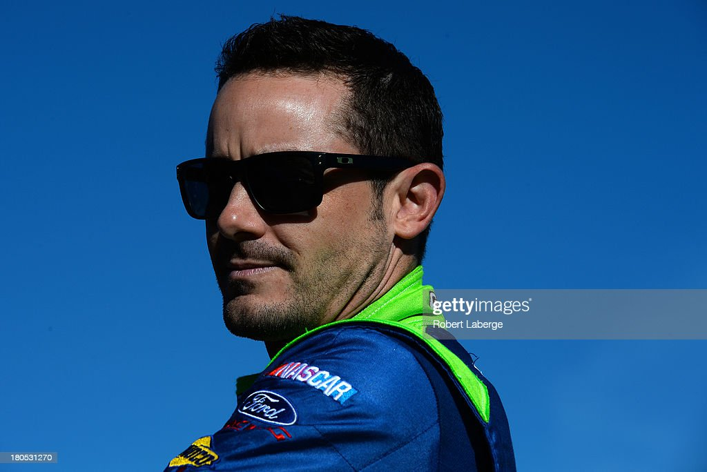 Casey Mears, driver of the #13 GEICO Ford, looks on during practice for the NASCAR Sprint Cup Series Geico 400 at Chicagoland Speedway on September 14, 2013 in Joliet, Illinois.