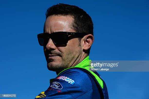 Casey Mears driver of the GEICO Ford looks on during practice for the NASCAR Sprint Cup Series Geico 400 at Chicagoland Speedway on September 14 2013...