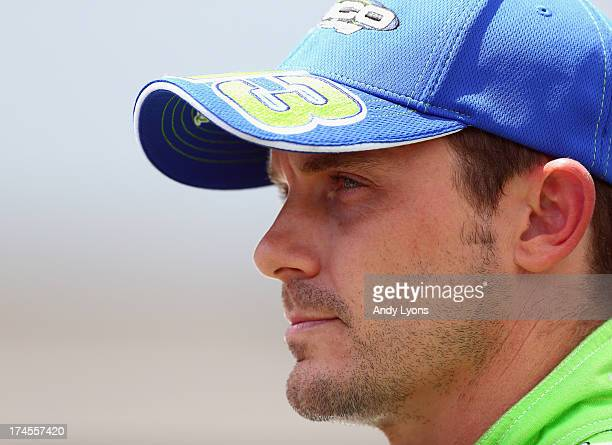 Casey Mears driver of the GEICO Ford looks on during qualifying for the NASCAR Sprint Cup Series Samuel Deeds 400 At The Brickyard at Indianapolis...