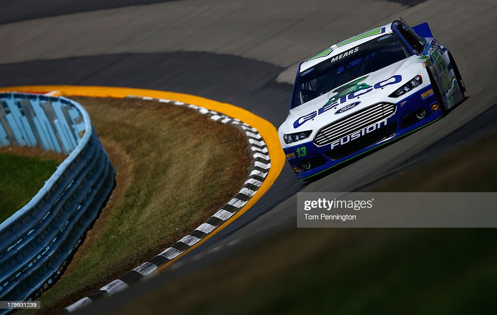 <a gi-track='captionPersonalityLinkClicked' href=/galleries/search?phrase=Casey+Mears&family=editorial&specificpeople=176485 ng-click='$event.stopPropagation()'>Casey Mears</a>, driver of the #13 GEICO Ford, qualifies for the NASCAR Sprint Cup Series Cheez-It 355 at The Glen at Watkins Glen International on August 10, 2013 in Watkins Glen, New York.