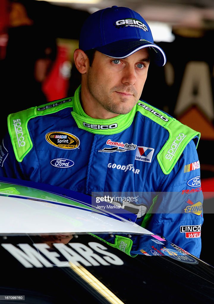 Casey Mears, driver of the #13 GEICO Ford, stands in the garage area during practice for the NASCAR Sprint Cup Series STP 400 at Kansas Speedway on April 20, 2013 in Kansas City, Kansas.