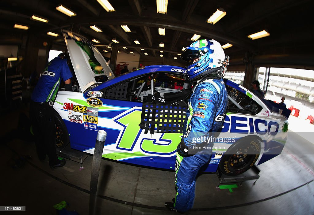 Casey Mears, driver of the #13 GEICO Ford, stands in the garage area during practice for the NASCAR Sprint Cup Series Samuel Deeds 400 At The Brickyard at Indianapolis Motor Speedway on July 26, 2013 in Indianapolis, Indiana.
