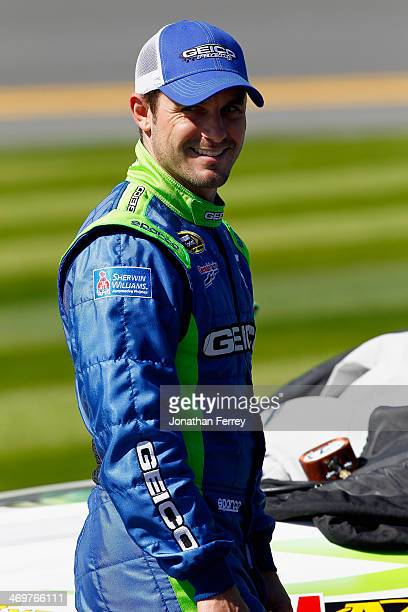 Casey Mears driver of the GEICO Ford stands on the grid during qualifying for the NASCAR Sprint Cup Series Daytona 500 at Daytona International...
