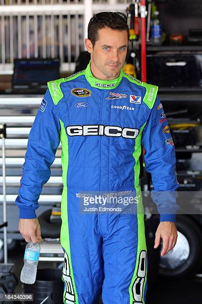 Casey Mears driver of the GEICO Ford walks in the garage during practice for the NASCAR Sprint Cup Series Auto Club 400 at Auto Club Speedway on...