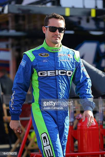 Casey Mears driver of the GEICO Ford walks to the garage area during practice for the NASCAR Sprint Cup Series Auto Club 400 at Auto Club Speedway on...