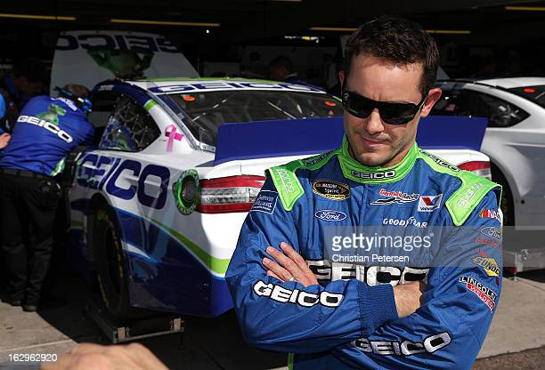 Casey Mears driver of the GEICO Toyota looks on from the garage area during practice for the NASCAR Sprint Cup Series Fresh Fit 500 at Phoenix...