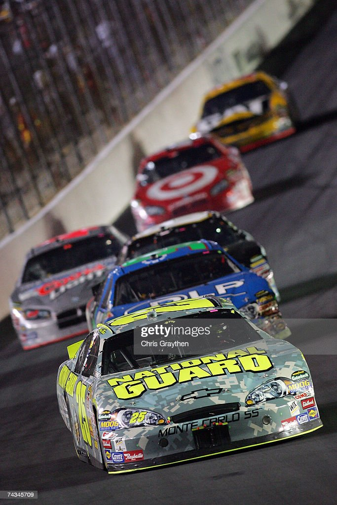 Casey Mears driver of the National Guard Chevrolet leads a group of cars during the NASCAR Nextel Cup Series CocaCola 600 on May 27 2007 at Lowe's...