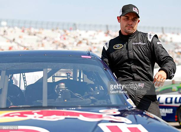 Casey Mears driver of the Red Bull Toyota gets out of his car after qualifying for the NASCAR Sprint Cup Series Autism Speaks 400 at Dover...