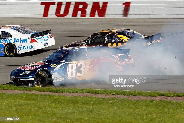 Casey Mears driver of the Red Bull Toyota spins out off the track after an incident with David Ragan driver of the UPS Ford during the NASCAR Sprint...