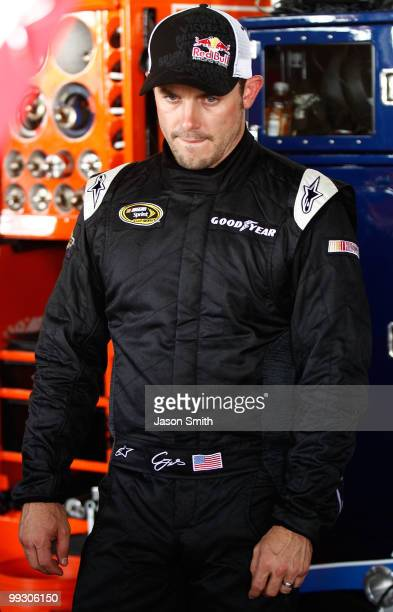 Casey Mears driver of the Red Bull Toyota stands in the garage during practice for the NASCAR Sprint Cup Series Autism Speaks 400 at Dover...