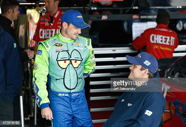 Casey Mears driver of the Squidward Tentacles Chevrolet stands in the garage area during practice for the NASCAR Sprint Cup Series SpongeBob...
