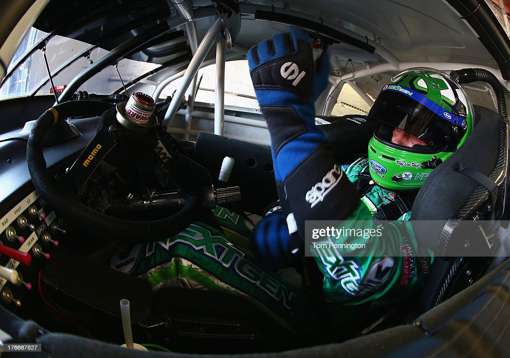 <a gi-track='captionPersonalityLinkClicked' href=/galleries/search?phrase=Casey+Mears&family=editorial&specificpeople=176485 ng-click='$event.stopPropagation()'>Casey Mears</a>, driver of the #13 Valvoline NextGen Ford, pulls on his gloves in his car during practice for the NASCAR Sprint Cup Series 44th Annual Pure Michigan 400 at Michigan International Speedway on August 17, 2013 in Brooklyn, Michigan.