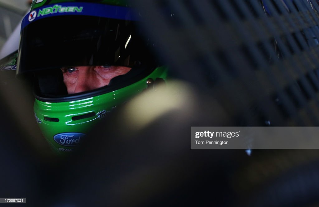 <a gi-track='captionPersonalityLinkClicked' href=/galleries/search?phrase=Casey+Mears&family=editorial&specificpeople=176485 ng-click='$event.stopPropagation()'>Casey Mears</a>, driver of the #13 Valvoline NextGen Ford, sits in his car during practice for the NASCAR Sprint Cup Series 44th Annual Pure Michigan 400 at Michigan International Speedway on August 17, 2013 in Brooklyn, Michigan.