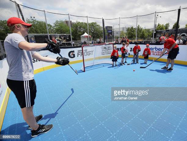 Casey Mittelstadt and former NHL player Denis Savard instruct children during the 2017 NHL Draft top prospects hockey clinic and media availabilty at...