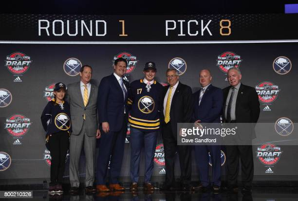 Casey Mittelstadt eighth overall pick of the Buffalo Sabres poses onstage for a photo with the Sabres draft team during Round One of the 2017 NHL...