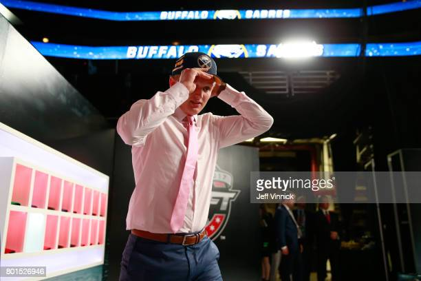 Casey Mittelstadt eighth overall pick of the Buffalo Sabres puts on his hat on his way to the stage during Round One of the 2017 NHL Draft at United...